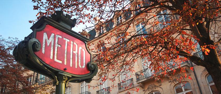Paris Metro sign in autumn