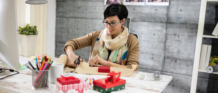 Freelance designer preparing holiday gifts