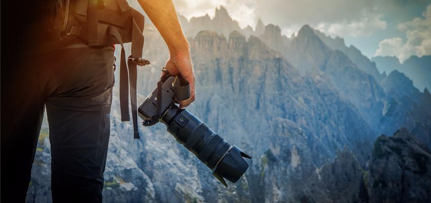 Stock photographer taking landscape photo